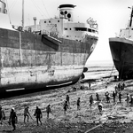 workers prepare to dismantle a ship
