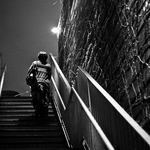Woman up the stairs